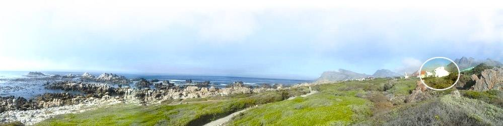 Panoramic view from coastal walkway towards Die Rotse Host House and Self-catering